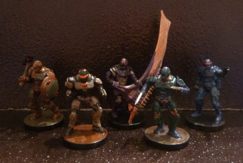 A group of five android miniatures