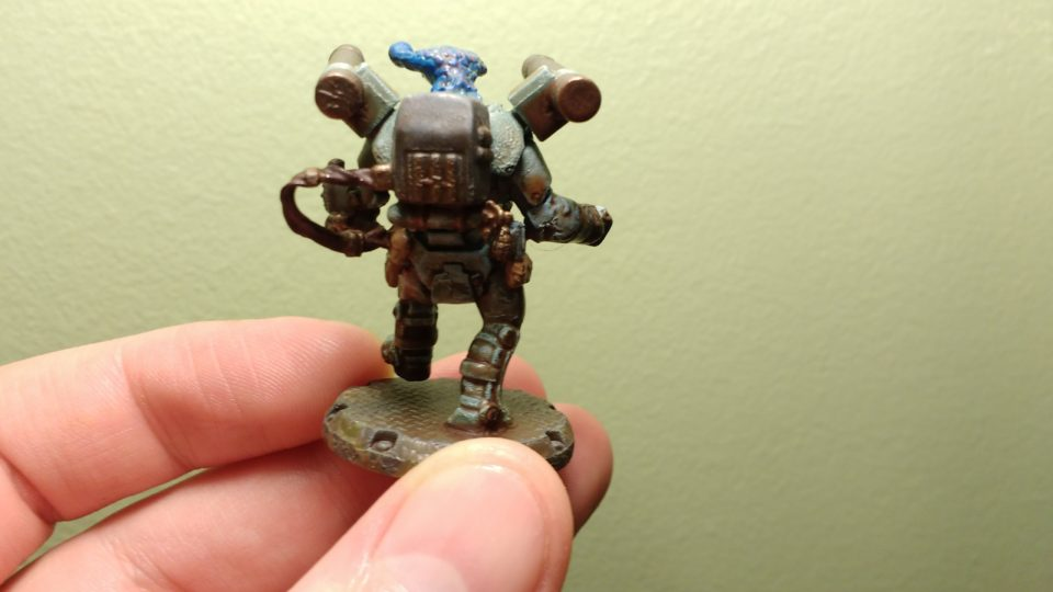 Back of a painted Dust Tactics NCO commander with an alien head