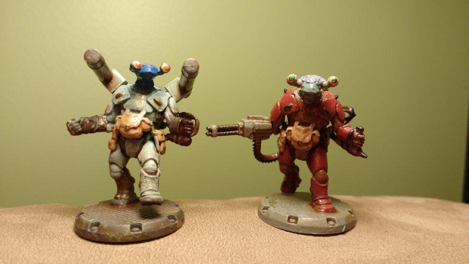 Comparison of two different painted Dust Tactics NCO Commander miniatures
