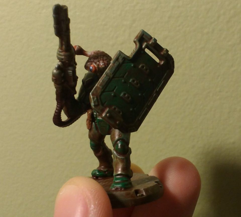 Front of a painted Dust Tactics Medic with an alien head