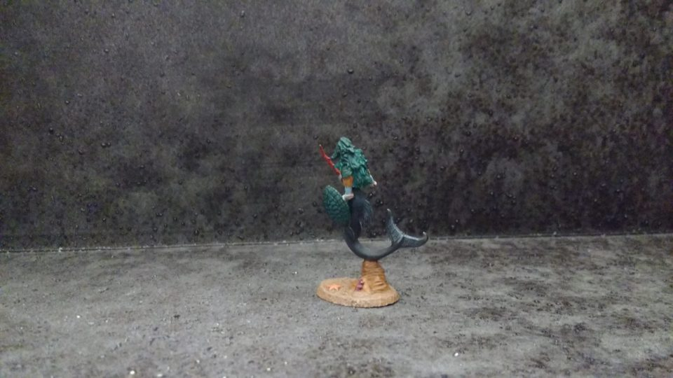 The Mermaid Warrior from Dark Sword Miniatures viewed from behind