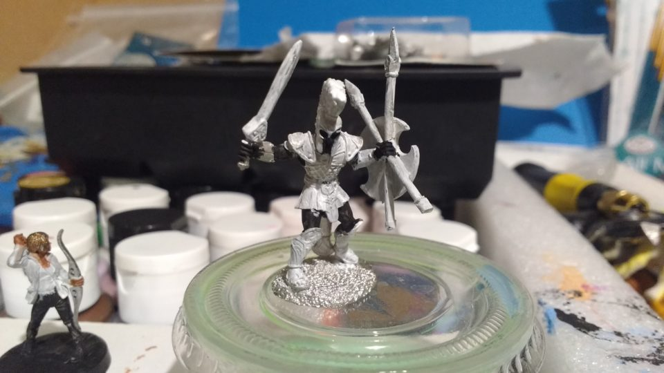 Urian Spartan Warrior miniature primed in black and white gesso