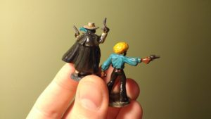 Photograph showing the back of two painted miniatures Horace 'Action' Johnson and The Black Mist