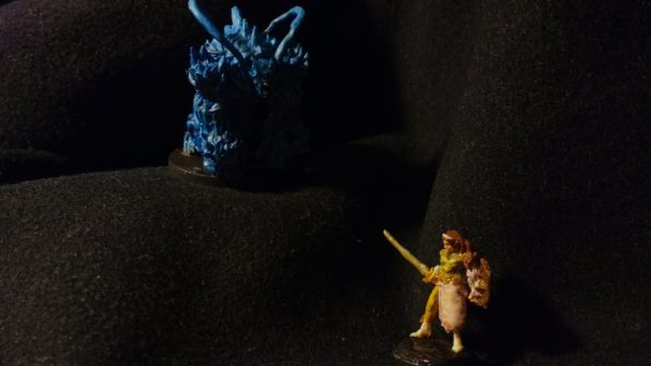Two miniatures converted to resemble Alisa Landale and the Dark Force from the original Phantasy Star game.