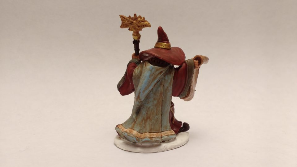 Galladon Male Wizard miniature from Reaper Bones. Viewed from back.