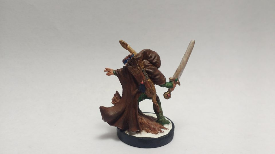 Nienna Female Elf Ranger miniature from Reaper Bones. Viewed from Back.