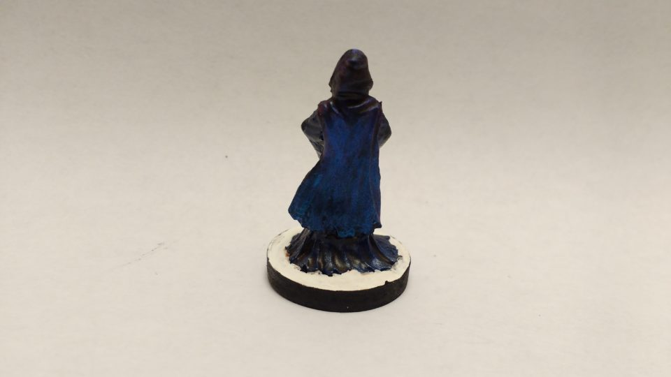 Aglanda Herald Of Razmir miniature from Reaper Bones. Viewed from the back.