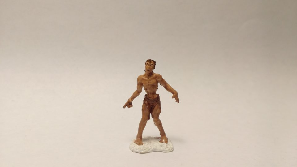 Zombie miniature from Reaper Bones. Viewed from front.