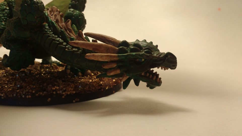Close up on the face of Marthrangul the Great Dragon miniature from Reaper Bones